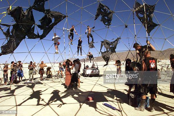 A group of people prepare the fighters under the 'Thunderdome' for a performance inspired in Mel Gibson's saga 'Mad Max' at Black Rock City's Burning...