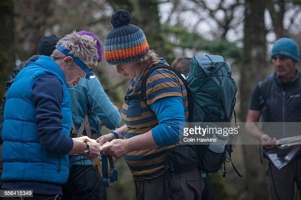 Group of people preparing to go orienteering