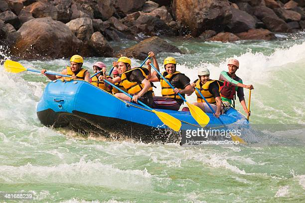 Group of people rafting in Ganges River Rishikesh Uttarakhand India