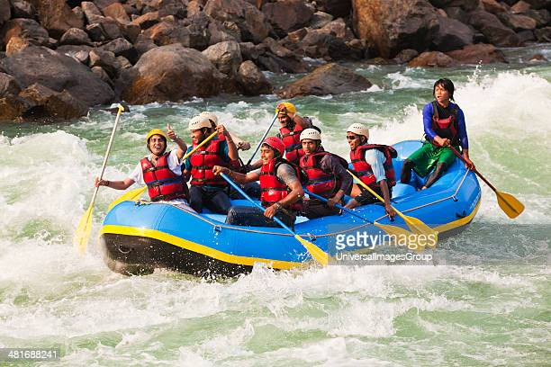 Group of people rafting in Ganges River, Rishikesh, Uttarakhand, India.