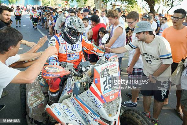 Group of people receiving the competitor PAULO GUARDIA MANCILLA of Chile with YAMAHA quad on the street before entering the Bivouac of the Dakar 2015...