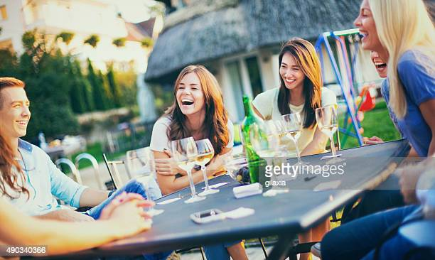 Group of people relaxing in backyard.