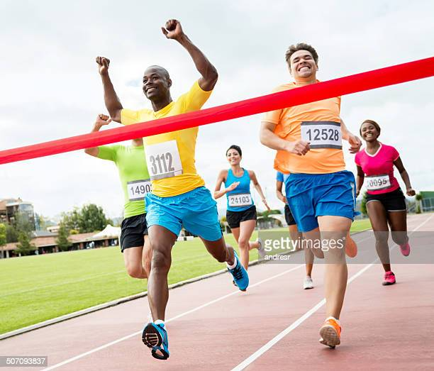 group of people running - finish line stock pictures, royalty-free photos & images