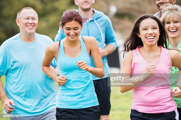 Group of people running together outside