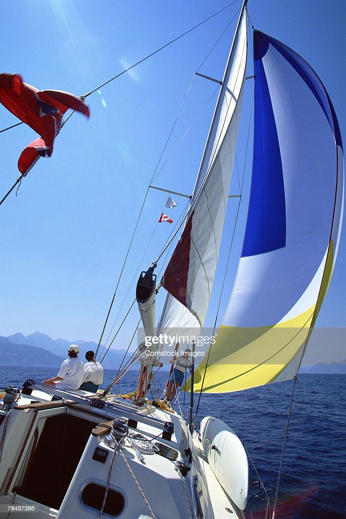 Group of people sailing : Stockfoto