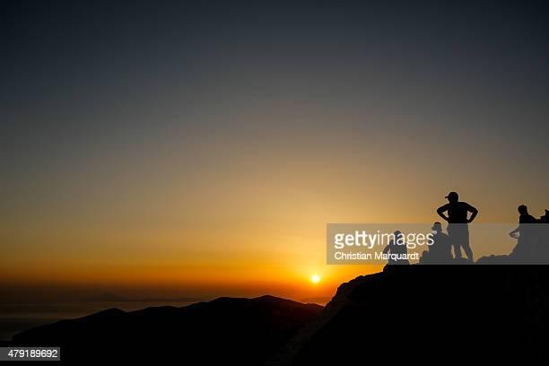 Group of people see the sunset in the town of Ano Meria on June 14 2015 in Folegandros Greece Folegandros is a small island with three villages in...