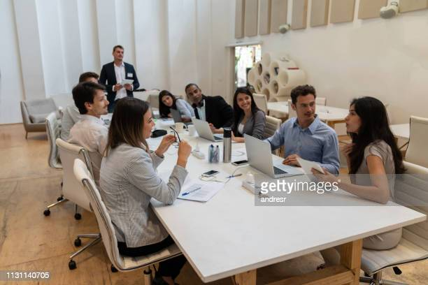 group of people sharing ideas in a business meeting at the office - human relationship stock pictures, royalty-free photos & images