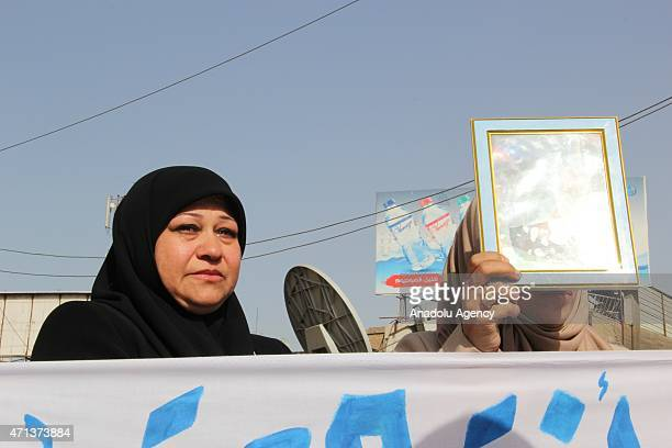 Group of people shout slogans and hold banners during protest demanding the dismissal of Iraqi Defense Minister Khaled al-Obeidi, at Tahrir Square in...