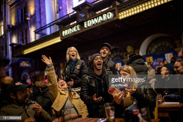 Group of people sing Happy Birthday while enjoying drinks on Old Compton Street in Soho on April 16, 2021 in London, England. Pubs and Restaurants...