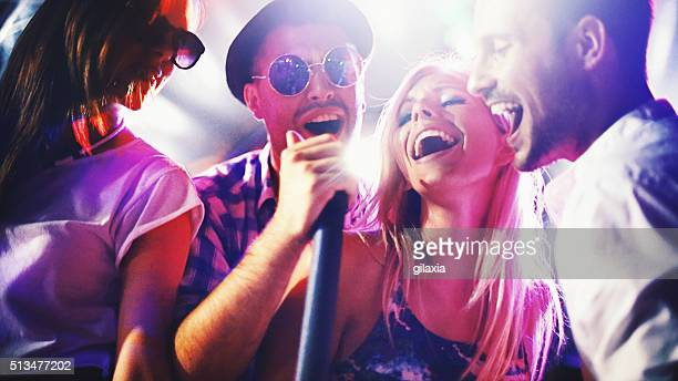 group of people singing karaoke. - the weekend singer stock pictures, royalty-free photos & images