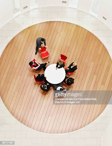 group of people sitting and looking at one man - medium group of people stock pictures, royalty-free photos & images