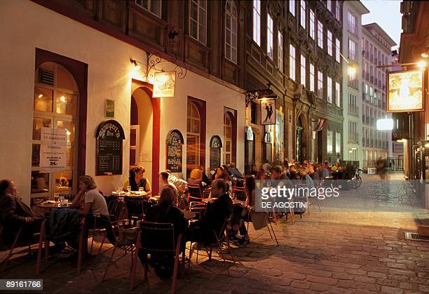 Group of people sitting at a sidewalk cafe Bermuda Triangle Vienna Austria