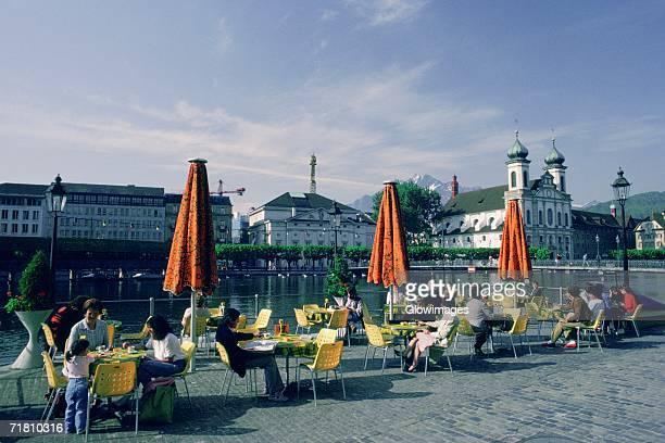 Group of people sitting at a sidewalk cafe, Lucerne, Switzerland