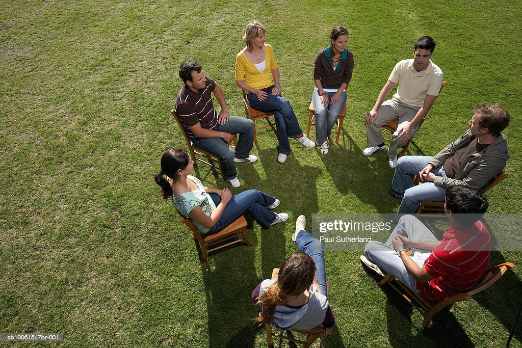 Group of people sitting on chairs in park, elevated view : Stock Photo