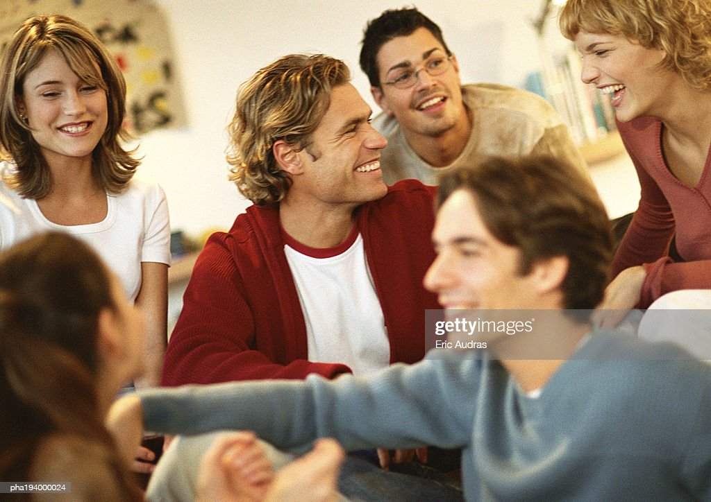 Group of people sitting together laughing, close-up. : Stockfoto