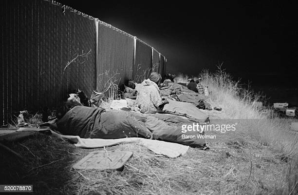 A group of people sleep outdoors at the Altamont Speedway Free Festival in Northern California held on Saturday December 6 1969