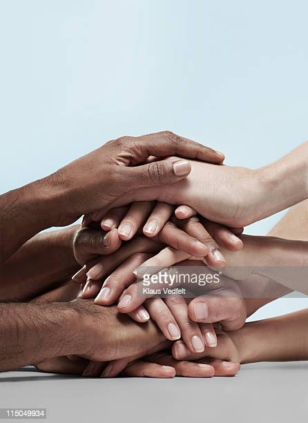 Group of people stacking hands on top of eachother