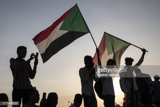 Group of people stage a demonstration call for the disbanding of Sudan's former ruling National Congress Party , which was headed by ousted President...