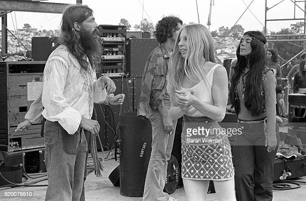 A group of people stand backstage at the Woodstock Music Festival Bethel NY August 15 1969