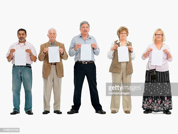group of people standing in a row holding papers - person holding blank sign stock pictures, royalty-free photos & images