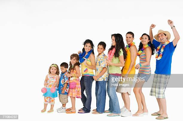group of people standing in a row - girl wear jeans and flip flops stock photos and pictures