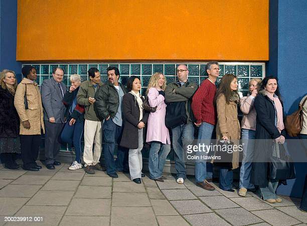 Group of people standing in line outdoors