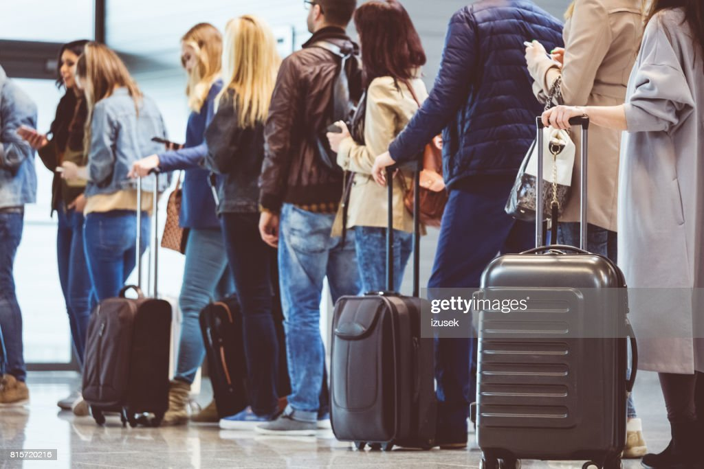 Group of people standing in queue at boarding gate : Stock Photo