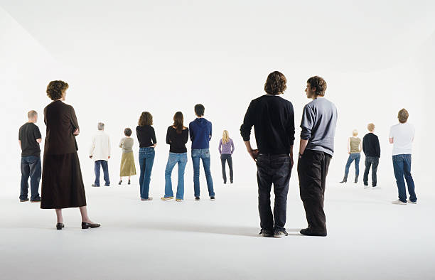 group of people standing in studio, rear view - people stock pictures, royalty-free photos & images