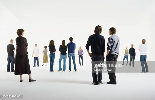 Group of people standing in studio, rear view