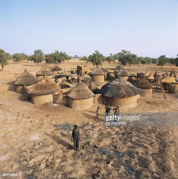 Serf Huts Group: Group Of People Standing Near Huts, Ouagadougou, Burkina