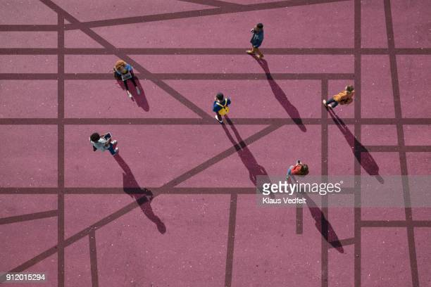 group of people standing & sitting on roads, painted on asphalt - social distancing stock-fotos und bilder