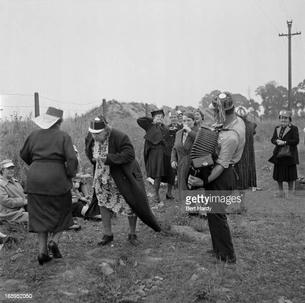 A group of people stop to dance to the music of an accordionist during a day out to Southend Essex 1952 Original publication Picture Post 5570...