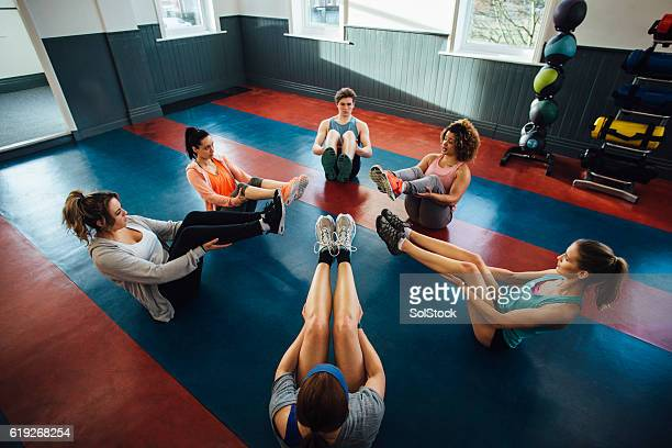 Group of People Stretching in Fitness Class