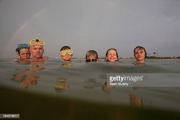 group of people swimming in the ocean with goggles - sea swimming stock pictures, royalty-free photos & images