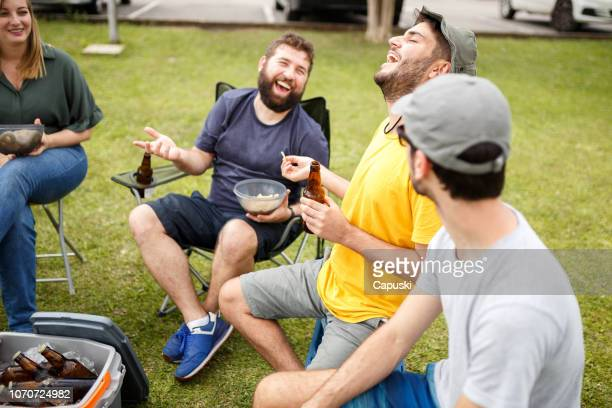 group of people tailgating and drinking beer - tailgate party stock pictures, royalty-free photos & images