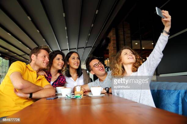 group people taking selfie at coffe