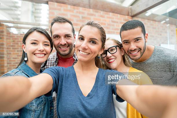 group of people taking a selfie at the office - self portrait photography stock pictures, royalty-free photos & images