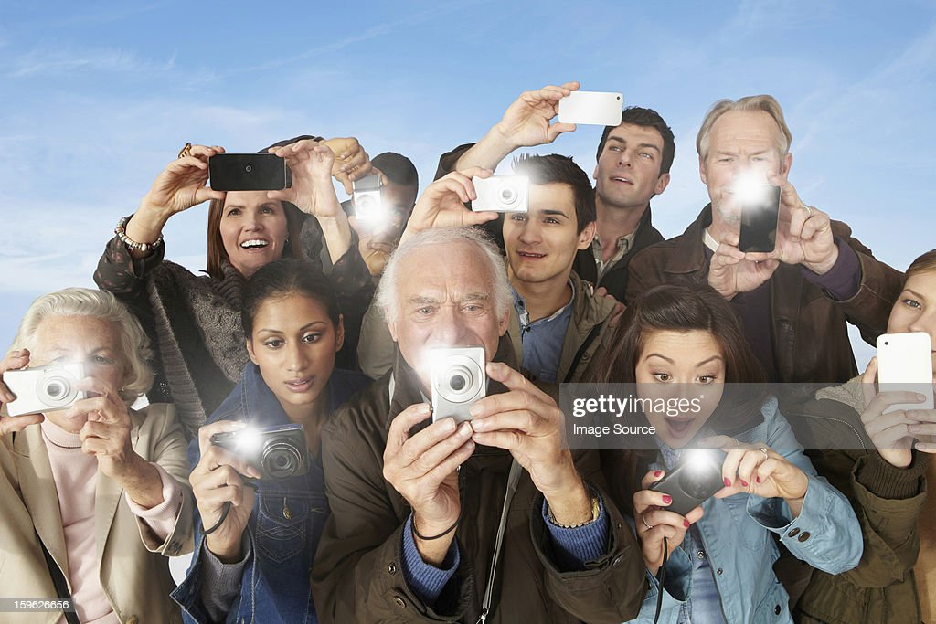 Group of people taking photographs : Stock Photo