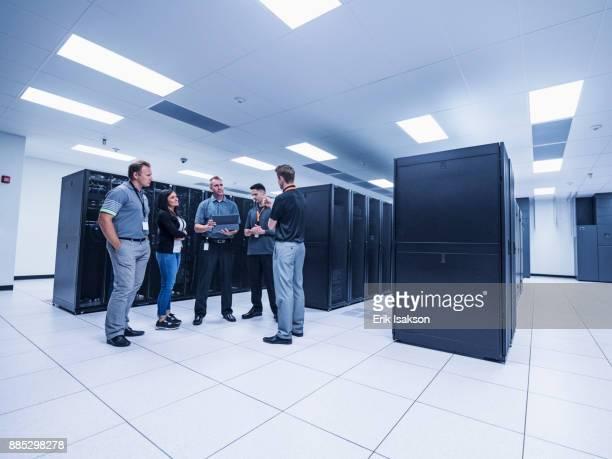 Group of people talking in server room