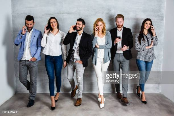 Group of people talking on phone