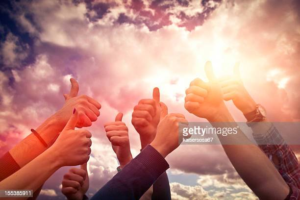 Group of people thumb up on the sky