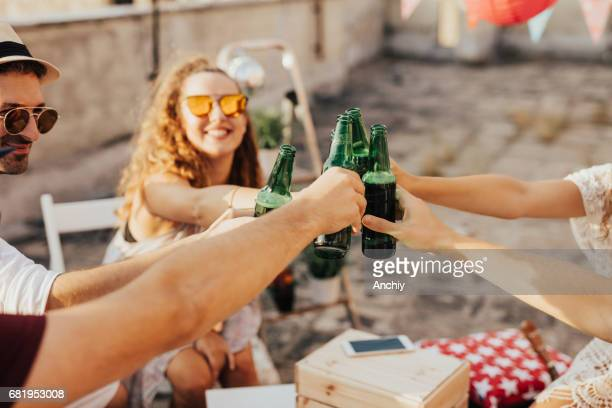 Group of people toasting together