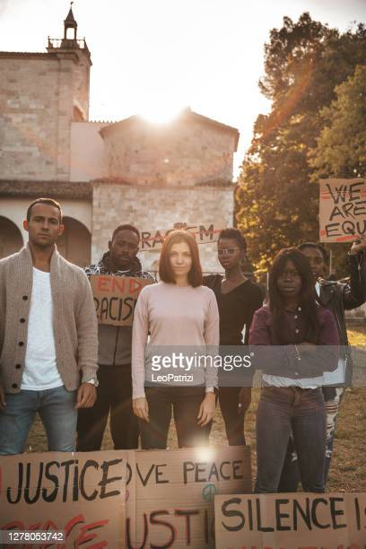 group of people together to say no to racism - police brutality stock pictures, royalty-free photos & images