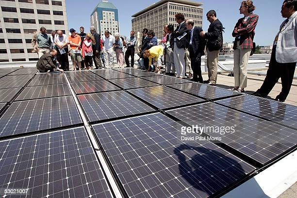 Group of people tour the solar panels on the top of the Moscone Center on June 4, 2005 in San Francisco, California. The panels can produce up to 675...