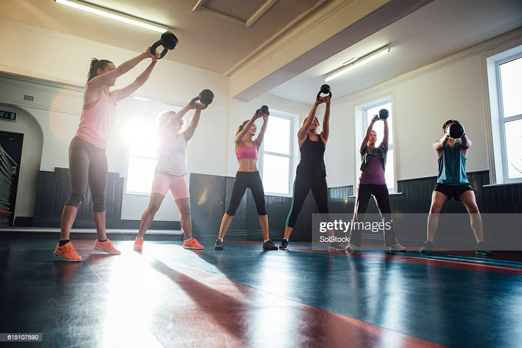Group of People Training with Kettle Bells : Stock Photo