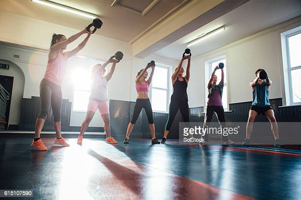 Group of People Training with Kettle Bells
