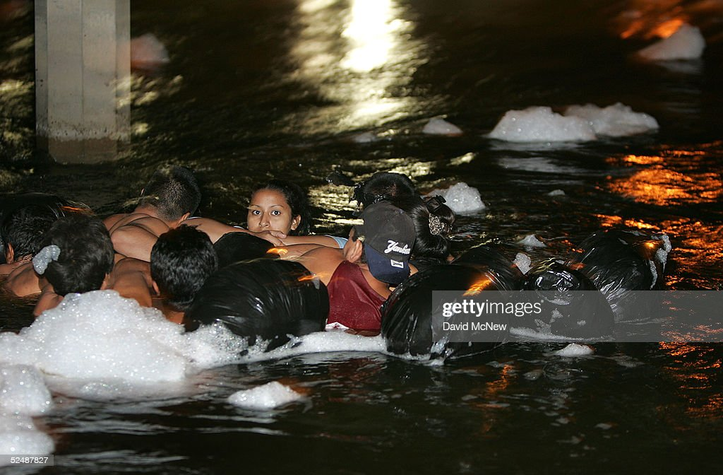 A group of people use inner tubes to float down the New River, reportedly the most polluted river in the US, after illegally crossing the US/Mexico border on March 27, 2005 near Calexico, California. The black plastic bags are for carrying a dry change of clothing so as to blend in with locals in the city, trying to avoid detection by US Border Patrol agents. Border Patrol agents avoid contact with the contaminated water because of its toxic chemicals, raw sewage, and 43 diseases reported to be in it, but prefer to nab floating immigrants after they come ashore. In 1995, the launch of the North American Free Trade Agreement (NAFTA) brought a two-way trade boom between the US and Mexico. The Bush administration has set forth efforts to tighten security to prevent terrorists or their weapons from crossing the border, an effort that could slow the wheels of commerce.