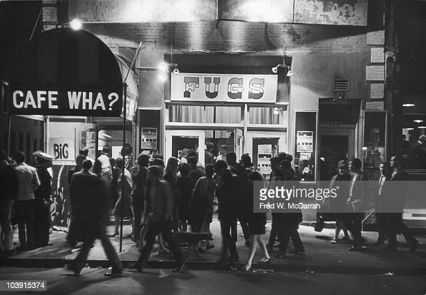 A group of people wait to get into the Cafe Wha nightclub for a performance by the Fugs New York New York May 22 1966