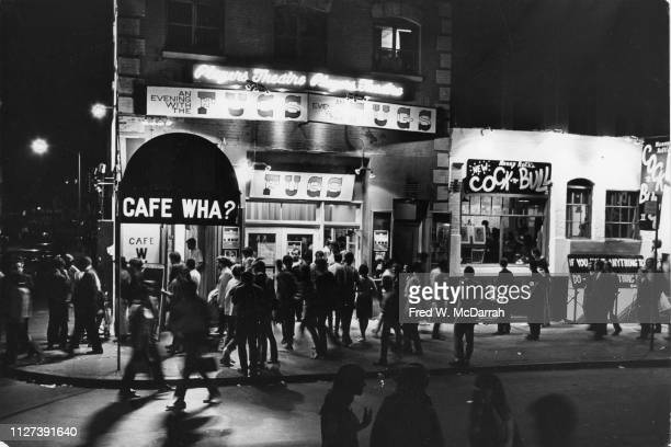 A group of people wait to get into the Cafe Wha nightclub for a performance by the Fugs New York New York June 25 1966