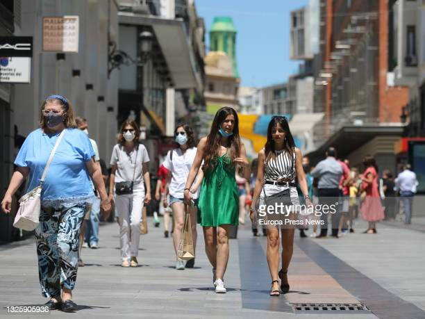 Group of people walk in the center of the capital, on June 28 in Madrid, . This is the first working day without the mandatory use of masks in open...